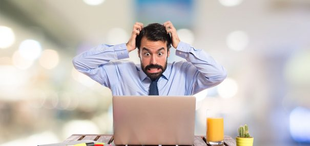 stock photo of man scratching his head frustrated