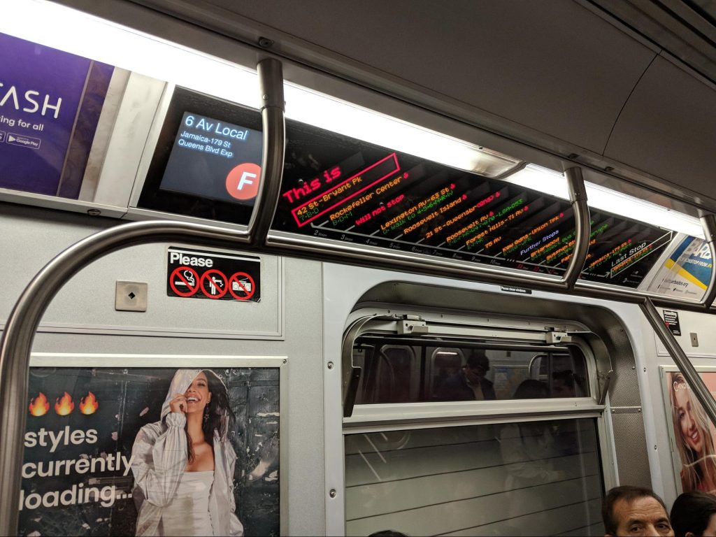 Inside a NYC subway train, an example of UX