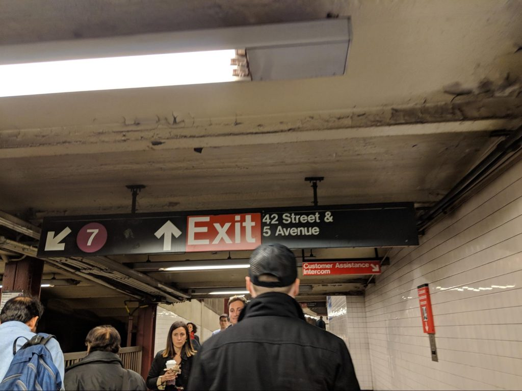 Exit sign in Subway station in NYC showing the use of UX in the real world